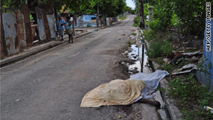 A body lies in the streets in the Trench Town neighborhood of Kingston, Jamaica, this week.