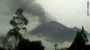 Picture released by Ecuadorean Army of the Tungurahua volcano as it is seen erupting.