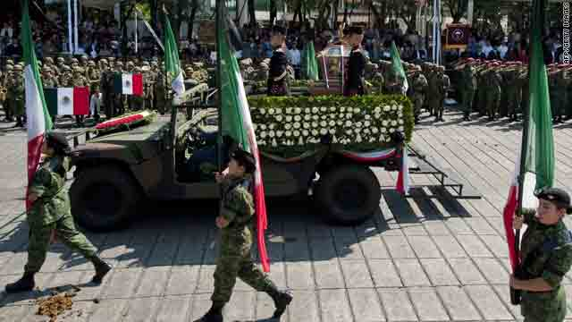 Soldiers in Mexico City escort a truck carrying the remains believed to include Miguel Hidalgo and seven other heroes on Sunday.