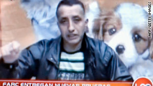 Grab from Colombian television purportedly shows police officer Luis Alberto Erazo speaking.