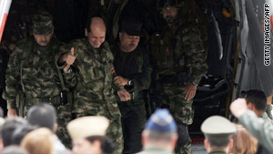Gen. Luis Herlindo Mendieta gives a thumbs up Monday. He is free after 12 years as a hostage of Colombian guerrillas.