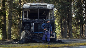 Ten Mexican police and an undisclosed number of criminals were killed in the convoy attack Monday, said officials.