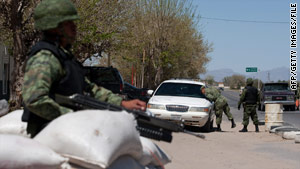 Soldiers man a checkpoint in April near Jaurez in Chihuahua state, one of Mexico's main drug war battlegrounds.