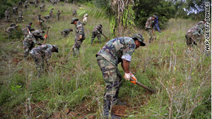 Bolivian soldiers destroy a coca plantation north of La Paz, Bolivia, on March 11.
