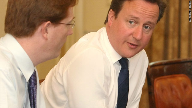 British PM David Cameron talks with Chief Secretary to the Treasury Danny Alexander in London on June 21, 2010.