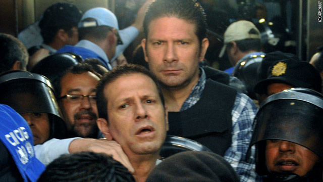 Francisco Jose Ramon Valdes Paiz (center-left) and his brother Jose Estuardo Valdes Paiz (center-right) leaving court on June 28, 2010 in Guatemala City.