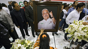 Rodolfo Torre Cantu, a candidate for governor of Mexico's Tamaulipas state, is mourned at his funeral Tuesday.