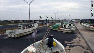 Boats are strewn across a street in Matamoros, Mexico, after Hurricane Alex passed through.