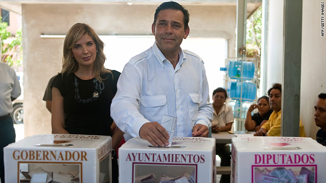 Eugenio Hernandez Floresand, governor of Tamaulipas state and member of PRI, casts his ballot in Ciudad Victoria on July 4. With him is his wife, Adriana Gonzalez.