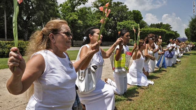 The wives of jailed Cuban dissidents  - known as the Ladies in White - pray in Havana's Fifth Avenue on Sunday.