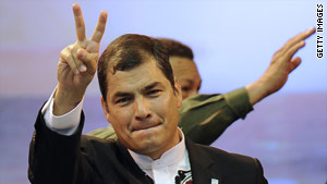 President Rafael Correa (front) and his Venezuelan counterpart Hugo Chavez (behind) wave on June 25, 2010, in Otavalo, Ecuador.