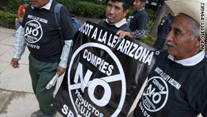Members of a Mexican farmers' cooperative protest Arizona's immigration law in Mexico City on Wednesday.
