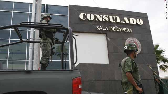 Mexican soldiers guard one of the entrances of the U.S. consulate in Ciudad Juarez, Chihuahua state, on Friday.