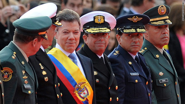 President Juan Manuel Santos (in sash) receives military honors during his inauguration Saturday in Bogota, Colombia.