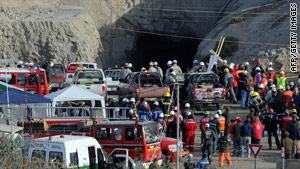 Rescuers, miners and relatives gather at the entrance to the San Esteban mine.