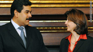 Venezuelan Foreign Minister Nicolas Maduro, left, met Colombian counterpart, Maria Angela Holguin, on Sunday.
