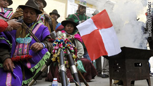 """Quechua Amautas"" perform a ritual during protests against the government over a land dispute in Potosi."
