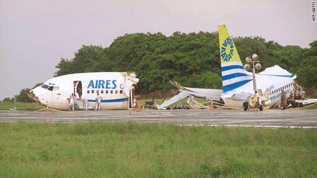 The Aires airline 737-700 jet lies in two parts after crashing early Monday on the Colombian island of San Andres.