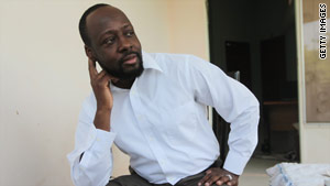 Wyclef Jean speaks with a journalist in Port-au-Prince, Haiti, on Thursday.