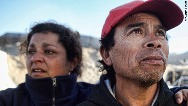 Relatives of the miners trapped in the San Esteban gold and copper mine wait for news in Chile on Sunday.