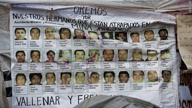 A banner shows pictures of the 33 miners trapped in the San Esteban gold and copper mine in Copiapo, northern Chile.
