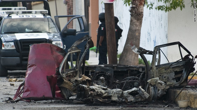 A burned vehicle lies in front of Televisa TV network after a car bomb explosion Friday in Ciudad Victoria, Mexico.