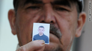 Gabriel Ortiz, father of a massacre victim, awaits word on the return of his son's body Monday in Tegucigalpa, Honduras.