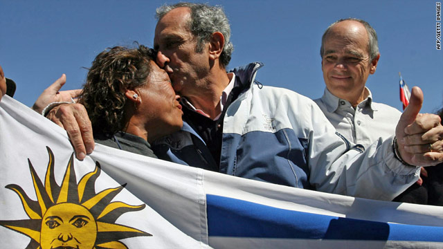 Uruguayan survivors of an aircraft that crashed in the Andes in 1972 stand with relatives of the trapped miners.