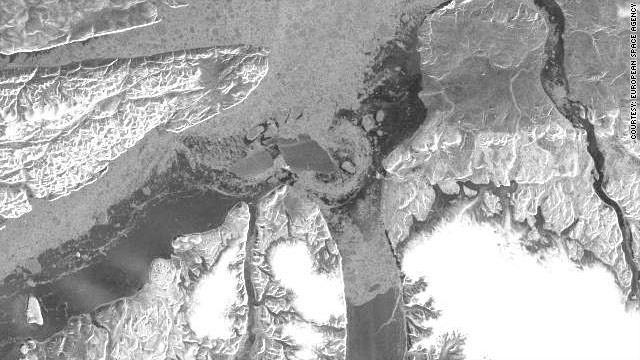 An image from ESA's ENVISAT satellite shows the ice island has split in two while passing through the Nares Strait.