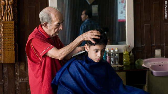 Cuban barbers, like this one working in Havana last month, became self-employed in April.