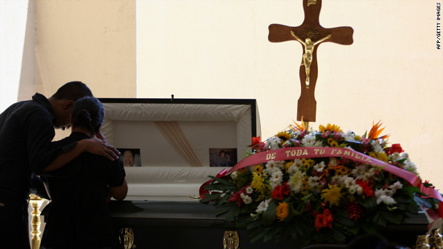 Relatives of murdered photojournalist Luis Carlos Santiago cry at his wake in Ciudad Juarez on Friday.