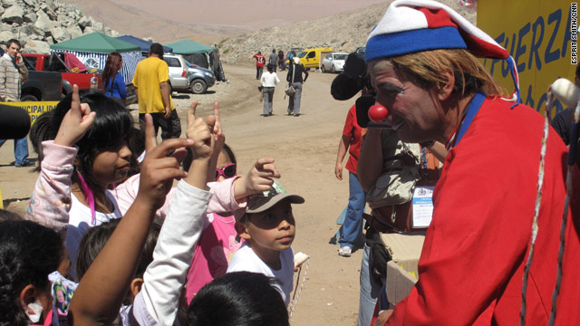 A clown tries to brighten independence day festivities for the children of miners trapped underground since August 5.