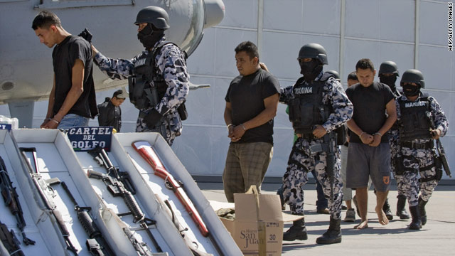 Members of Mexico's Gulf Cartel are shown to the press after being detained in Tamaulipas State on Tuesday.