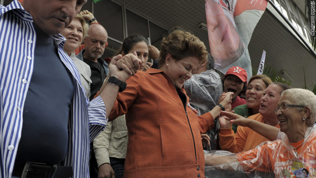 Dilma Rousseff (center), presidential candidate for the ruling Workers Party (PT), attends a campaign rally on October 2.