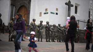 Ecuadorean soldiers stand guard at Independence Square in downtown Quito on Sunday.
