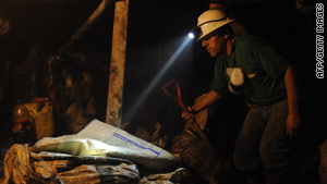 On Sunday, a miner who's part of the rescue team searches  for the missing miners in Ecuador.