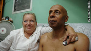 Cuban political dissident Guillermo Farinas, right, with Laura Pollan, leader of opposition movement Ladies in White.