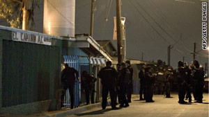 Mexican federal police investigate the shootings at a Tijuana rehab facility on Sunday, October 24.
