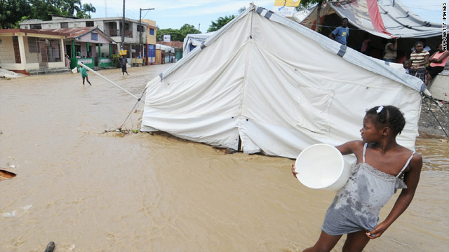 Rainwater from Tropical Storm Tomas floods a tent and a street Saturday in Leogane, Haiti.