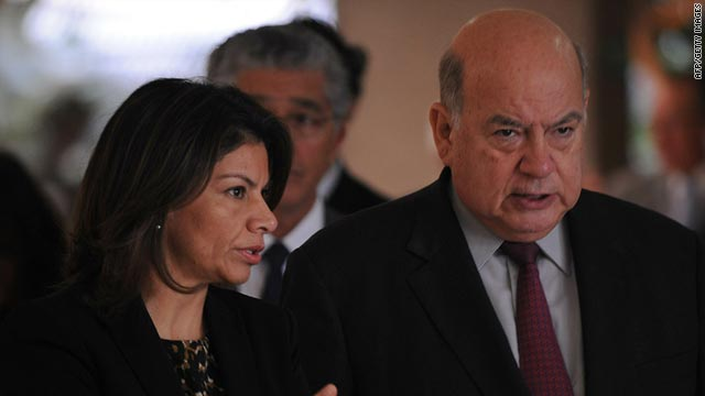 Costa Rican President Laura Chinchilla speaks with OAS Secretary-General Jose Miguel Insulza Saturday in San Jose.