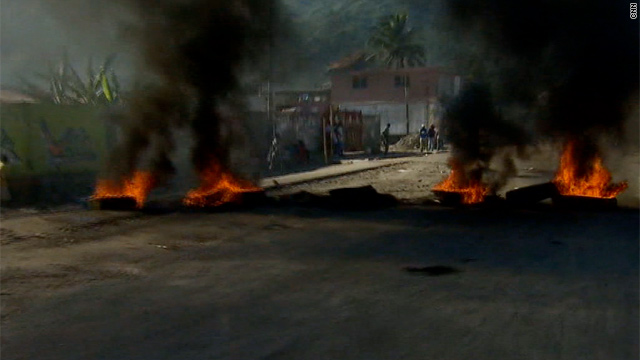Angry over the cholera epidemic, demonstrators have put up networks of barricades through the streets of Cap-Haitien, Haiti.