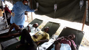 Cholera patients rest at a makeshift hospital in Hinche, Haiti, on Sunday.