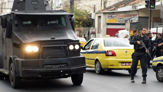 A police armored vehicle patrols the streets near the Vila Cruzeiro favela in Rio de Janeiro.
