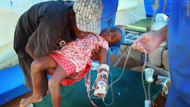 A Haitian child being treated for cholera is placed on a cot at a Samaritan's Purse facility in Cabaret, Haiti, on Tuesday.