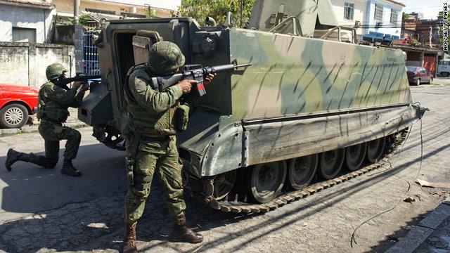 Brazilian navy soldiers patrol Vila Cruzeiro shantytown on November 26, 2010 in Rio De Janeiro, Brazil.