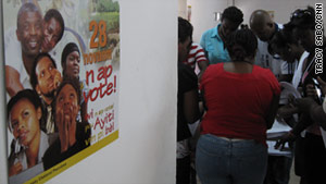 Workers prepare for Sunday's vote at an election facility in Port-au-Prince, Haiti.