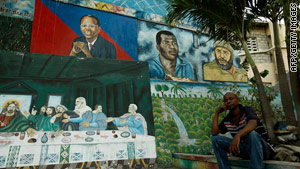 A Port-au-Prince wall painting depicts Jesus, ex-President Aristide, footballer Emmanuel Sanon and Cuba's Fidel Castro.