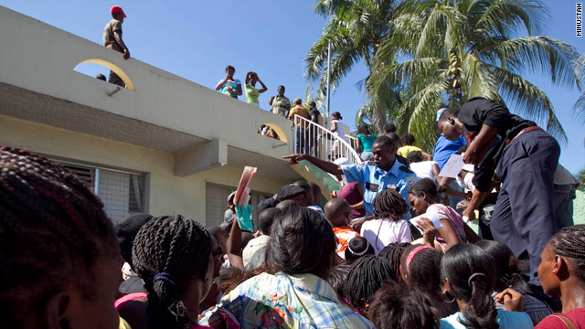 Haitians queue for electoral identification cards the day before the country's presidential election on Sunday, November 28, 2010.
