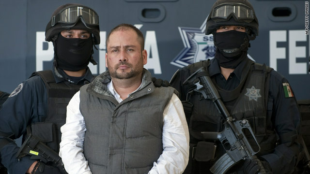 Arturo Gallegos Castrellon makes an appearance at federal police headquarters in Mexico City on Sunday.