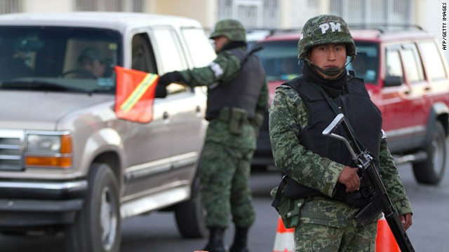 Mexican army soldiers patrol the streets of Ciudad Juarez in November, but security responsibility falls to the federal police.